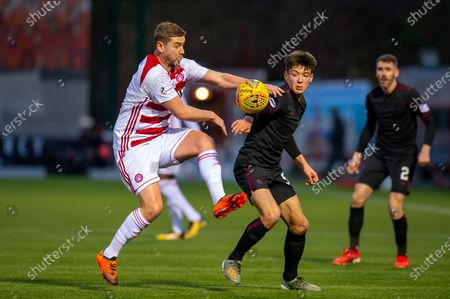 Stock Photo of Steve Davis (#8) of Hamilton Academical FC tackles Aaron Hickey (#51) of Heart of Midlothian FC during the Ladbrokes Scottish Premiership match between Hamilton Academical FC and Heart of Midlothian at The Fountain of Youth Stadium, Hamilton