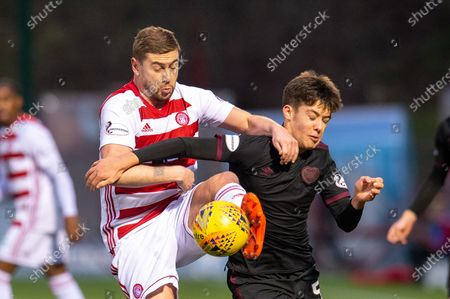 Steve Davis (#8) of Hamilton Academical FC challenges Aaron Hickey (#51) of Heart of Midlothian FC during the Ladbrokes Scottish Premiership match between Hamilton Academical FC and Heart of Midlothian at The Fountain of Youth Stadium, Hamilton