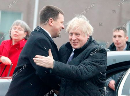 Estonian Prime Minister Juri Ratas (L) welcomes British Prime Minister Boris Johnson (R) at Tapa military campus, in Tapa, Estonia, 21 December 2019. Boris Johnson is on a one-day visit to Estonia and has meeting with British troops from NATO's battle group at Tapa.