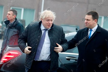 Estonian Prime Minister Juri Ratas (R) welcomes British Prime Minister Boris Johnson (C), during their meeting at Tapa military campus, in Tapa, Estonia, 21 December 2019. Boris Johnson is on a one-day visit to Estonia and has meeting with British troops from NATO's battle group at Tapa.