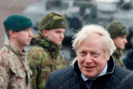 British Prime Minister Boris Johnson arrives to meet Estonian Prime Minister Juri Ratas and the British troops at Tapa military campus in Tapa, Estonia, 21 December 2019. Boris Johnson is on a one-day visit to Estonia and has meeting with British troops from NATO's battle group at Tapa.