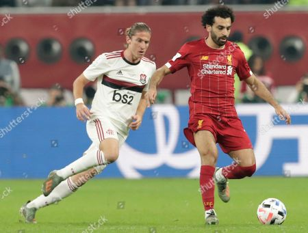 Flamengo's Filipe Luis, left, challenges Liverpool's Mohamed Salah, right, during the Club World Cup final soccer match between Liverpool and Flamengo at Khalifa International Stadium in Doha, Qatar