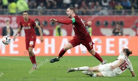 Flamengo's Filipe Luis, right, challenges Liverpool's Jordan Henderson, left, during the Club World Cup final soccer match between Liverpool and Flamengo at Khalifa International Stadium in Doha, Qatar