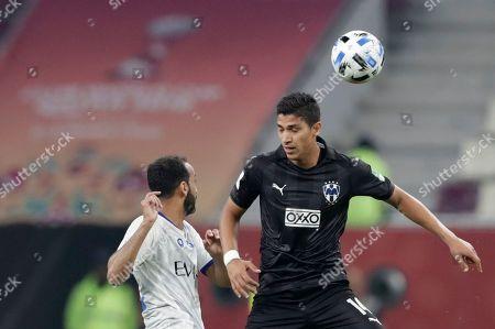 Al Hilal's Abdullah Otayf, left, challenges Monterrey's Angel Zaldivar, right, during the Club World Cup third place soccer match between Al Hilal and Monterrey at Khalifa International Stadium in Doha, Qatar