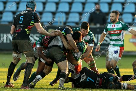 Zebre vs Benetton Rugby. Benetton's Leonardo Sarto tackled by Zebre's Giosue Zilocchi