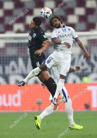 Monterrey's Angel Zaldivar vies for the ball with Al Hilal's Yasser Al Shahrani during the Club World Cup third place soccer match between Al Hilal and Monterrey at Khalifa International Stadium in Doha, Qatar