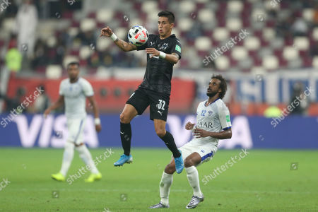 Monterrey's Maximiliano Meza, left, vies for the fall with Al Hilal's Yasser Al Shahrani during the Club World Cup third place soccer match between Al Hilal and Monterrey at Khalifa International Stadium in Doha, Qatar
