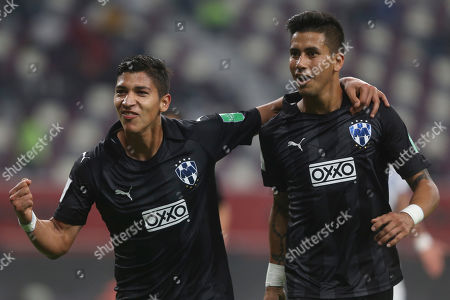 Monterrey's Maximiliano Meza, right, celebrates after scoring his side's second goal with Monterrey's Angel Zaldivar during the Club World Cup third place soccer match between Al Hilal and Monterrey at Khalifa International Stadium in Doha, Qatar