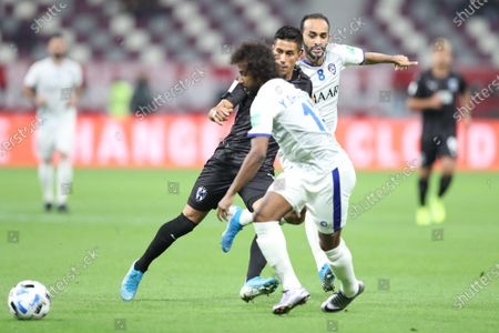 Maximiliano Meza (C) of CF Monterrey in action against Yasser Al Shahrani of Al Hilal SFC during the FIFA Club World Cup third place soccer match between CF Monterrey and Al Hilal SFC in Doha, Qatar, 21 December 2019.