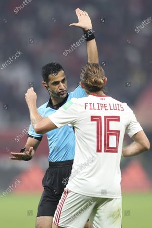 Referee Abdulrahman Al Jassim (L) and Filipe Luis of Flamengo (R) during the FIFA Club World Cup 2019 final soccer match between Liverpool FC and CR Flamengo in Doha, Qatar 21 December 2019.