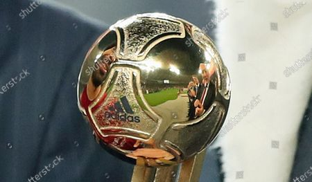 Mohamed Salah of Liverpool FC is reflected in the trophy as he is awarded as best player by Sheikh Joaan bin Hamad bin Khalifa Al Thani (not pictured) after the FIFA Club World Cup 2019 final soccer match between Liverpool FC and CR Flamengo in Doha, Qatar 21 December 2019.