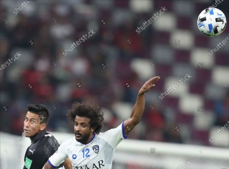Maximiliano Meza (L) of CF Monterrey in action against Yasser Al Shahrani of Al Hilal SFC during the FIFA Club World Cup third place soccer match between CF Monterrey and Al Hilal SFC in Doha, Qatar, 21 December 2019.