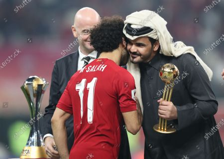 Stock Photo of Mohamed Salah (C) of Liverpool FC receives the trophy of best player from Sheikh Joaan bin Hamad bin Khalifa Al Thani (R) after the FIFA Club World Cup 2019 final soccer match between Liverpool FC and CR Flamengo in Doha, Qatar 21 December 2019.