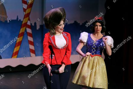 Hillary Clinton and Snow White are portrayed by Jennifer Morrison, left, and Ruby Day, right, during a performance of the musical Beach Blanket Babylon in San Francisco. The campy small San Francisco show that's been a must-see for tourists and locals alike for more than 45 years, making it the nation's longest continuously running musical revue, is closing its curtain. Its final performance is set for New Year's Eve