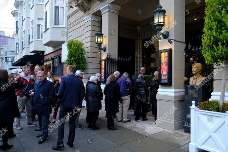 """In this, people line up outside the Club Fugazi to see one of the last performances of the musical """"Beach Blanket Babylon"""" in San Francisco. The final performance of the small campy San Francisco show is set for New Year's Eve"""