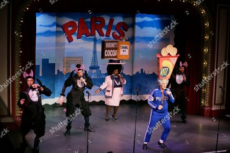 """Stock Photo of Characters portraying French poodles, Coco Chanel and Vladimir Putin perform during the musical """"Beach Blanket Babylon"""" in San Francisco. The campy small San Francisco show that's been a must-see for tourists and locals alike for more than 45 years, making it the nation's longest continuously running musical revue, is closing its curtain. Its final performance is set for New Year's Eve"""