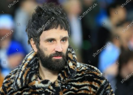 Stock Image of Lead singer from British band Kasabian,Sergio Pizzorno reacts during the English Premier League soccer match between Manchester City and Leicester City held at the Etihad stadium in Manchester, Britain, 21 December 2019.