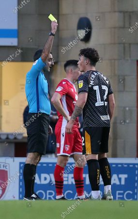 Danny McNamara of Newport County gets a yellow from referee Paul Marsden in the 2nd half