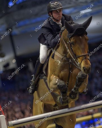 Stock Picture of Ben Maher (GBR) F One USA in action in the London Leg of The Longines FEI Jumping World Cup.