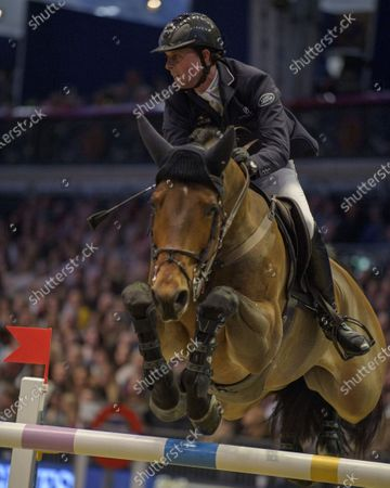 Stock Image of Ben Maher (GBR) F One USA in action in the London Leg of The Longines FEI Jumping World Cup.