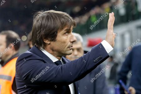 Inter Milan's head coach Antonio Conte waves to fans at the end of the Serie A soccer match between Inter Milan and Genoa, at the San Siro stadium in Milan, Italy, . Inter won 4-0. AP Photo/Luca Bruno