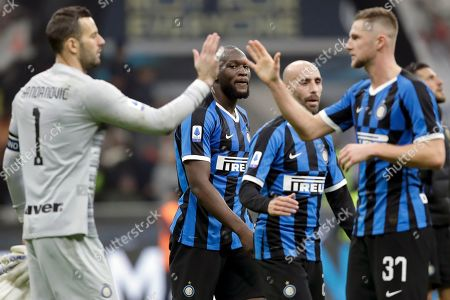 Stock Image of Inter Milan's goalkeeper Samir Handanovic, left, and his teammate Milan Skriniar congratulate each other as Romelo Lukaku, center, looks at them, at the end of theSerie A soccer match between Inter Milan and Genoa, at the San Siro stadium in Milan, Italy, . Inter won 4-0