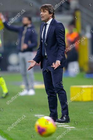 Inter Milan's head coach Antonio Conte follows the Serie A soccer match between Inter Milan and Genoa, at the San Siro stadium in Milan, Italy