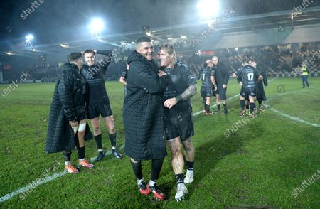Leon Brown and Richard Hibbard of Dragons celebrates at the end of the game.