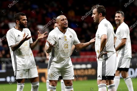 Stock Photo of (L-R) Goldstandard World Stars' players Dani Alves, Roberto Carlos and Alessandro Del Piero in action during their charity soccer game between Spanish National Team Legends and Goldstandard World Stars played in Wanda Metropolitano Stadium, in Madrid, Spain, 21 December 2019. The money raised in the event will be destined to fight Amyotrophic lateral sclerosis (ALS) and help wheelchair-soccer development.