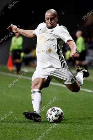 Goldstandard World Stars' Roberto Carlos in action during the charity soccer game between Spanish National Team Legends and Goldstandard World Stars played in Wanda Metropolitano Stadium, in Madrid, Spain, 21 December 2019. The money raised in the event will be destined to fight Amyotrophic lateral sclerosis (ALS) and help wheelchair-soccer development.