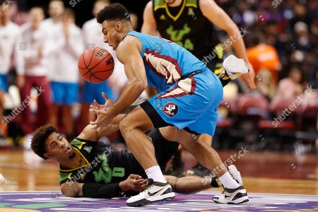 Anthony Polite, David Collins. Florida State guard Anthony Polite, right, and South Florida guard David Collins (0) battle for a loose ball in the first half of an NCAA college basketball game, part of the Orange Bowl Classic tournament, in Sunrise, Fla