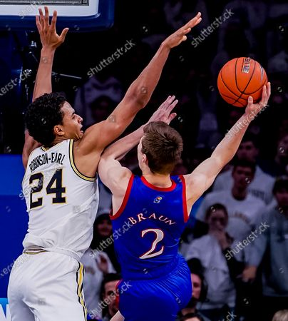 , 2019, Philadelphia, PA, USA: Kansas forward Christian Braun #2 tries to take a shot over Villanova forward Jeremiah Robinson-Earl #24 during the NCAA basketball matchup between the Kansas Jayhawks and Villanova Wildcats at the Wells Fargo Center in Philadelphia, Pennsylvania.The 18th-ranked Wildcats defeated the #1-ranked Jayhawks 56-55