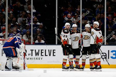 Stock Picture of Anaheim Ducks center Adam Henrique (14) celebrates his goal against New York Islanders goaltender Semyon Varlamov (40) with teammates Devin Shore (29), Michael Del Zotto (44) and Korbinian Holzer (5) during the second period of an NHL hockey game, in Uniondale, N.Y