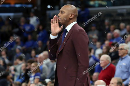 Memphis head coach Penny Hardaway calls to his players in the first half of an NCAA college basketball game against Jackson State, in Memphis, Tenn
