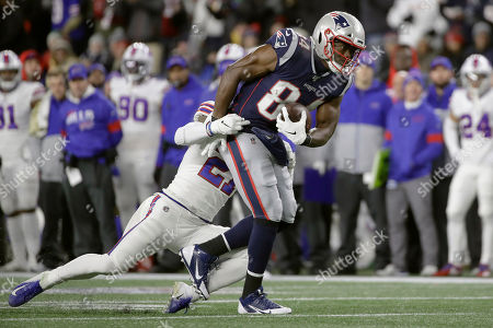 Buffalo Bills safety Jordan Poyer, rear, tackles New England Patriots tight end Benjamin Watson after he caught a pass in the first half of an NFL football game, in Foxborough, Mass