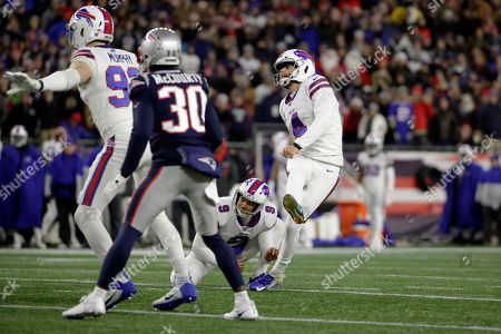 Buffalo Bills kicker Steven Hauschka follows through on a successful field goal attempt in the first half of an NFL football game against the New England Patriots, in Foxborough, Mass