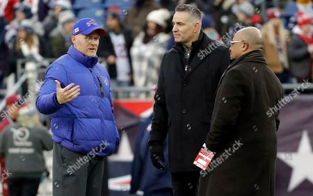 Buffalo Bills head coach Sean McDermott, left, talks to NFL Network broadcasters Kurt Warner, center, and Mike Tirico on the field as teams warm up before an NFL football game between the Bills and the New England Patriots, in Foxborough, Mass