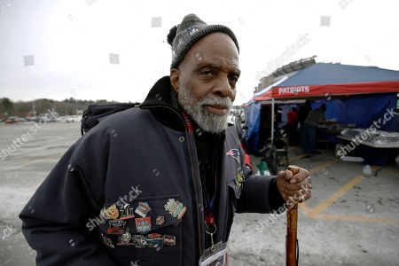 James Woods, 88, of Boston, a New England Patriots season ticket holder since 1984, spends time tailgating in the parking lot of Gillette Stadium before an NFL football game between the Patriots and the Buffalo Bills, in Foxborough, Mass