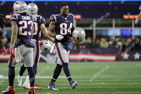 New England Patriots tight end Benjamin Watson walks on the field in the second half of an NFL football game against the Buffalo Bills, in Foxborough, Mass