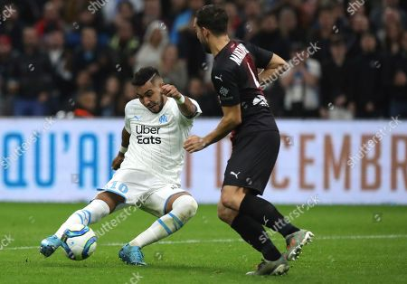 Marseille's Dimitri Payet, left, scores his side's third goal during the French League One soccer match between Marseille and Nimes at the Velodrome stadium in Marseille, southern France