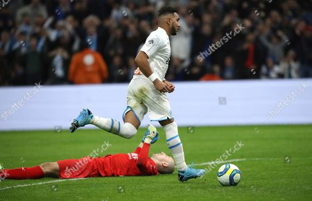 Stock Image of Marseille's Dimitri Payet runs after scoring his side's third goal during the French League One soccer match between Marseille and Nimes at the Velodrome stadium in Marseille, southern France