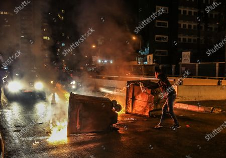 Supporters of Outgoing Prime Minister Saad Hariri close the road by burn Waste dump and car tires during a protest against the newly appointed Lebanese Prime Minister Hassan Diab, at Al-Barbir neighborhood in Beirut, Lebanon, 21 December 2019. Lebanon's premier designate Hassan Diab vowed on 19 December to form a government of experts. However, Sunni protesters blocked roads with burning car tires to protest the appointment of Diab, who has the support of Shiite group Hezbollah.