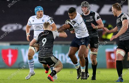 Rey Lee-Lo of Cardiff Blues smashes past Aled Davies of Ospreys.