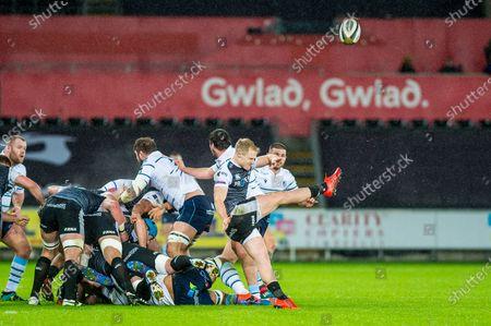 Aled Davies of Ospreys  kicks the ball out