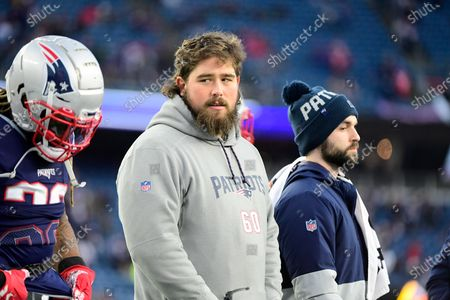 New England Patriots center David Andrews (60) walks with teammates before the NFL football game between the Buffalo Bills and the New England Patriots at Gillette Stadium, in Foxborough, Massachusetts. The Patriots defeat the Bills 24-17