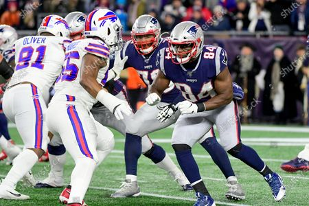 Stock Image of New England Patriots tight end Benjamin Watson (84) lines up a block on Buffalo Bills defensive end Jerry Hughes (55) during the NFL football game between the Buffalo Bills and the New England Patriots at Gillette Stadium, in Foxborough, Massachusetts. The Patriots defeat the Bills 24-17