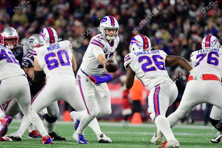 Buffalo Bills quarterback Josh Allen (17) hands the ball to running back Devin Singletary (26) during the NFL football game between the Buffalo Bills and the New England Patriots at Gillette Stadium, in Foxborough, Massachusetts. The Patriots defeat the Bills 24-17