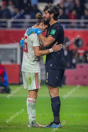 Liverpool goalkeeper Alisson comforts Filipe Luis of Flamengo