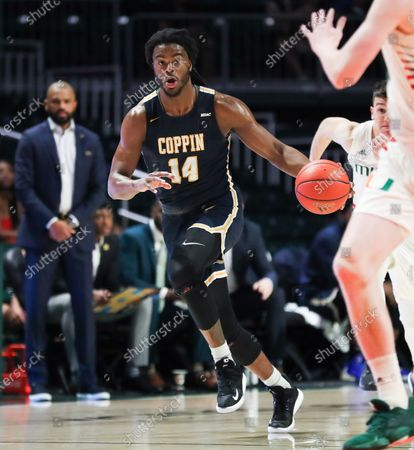 Coppin State Eagles guard Andrew Robinson (14) moves the ball during the NCAA men's basketball game against the Miami Hurricanes at the Watsco Center in Coral Gables, Florida. Miami won 91-60