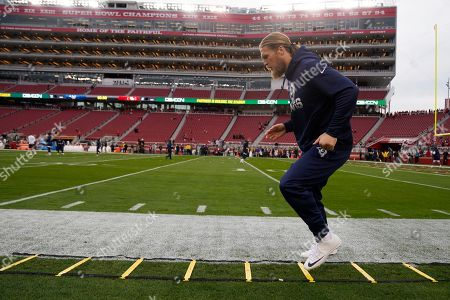 Stock Image of Los Angeles Rams outside linebacker Clay Matthews warms up before an NFL football game against the San Francisco 49ers in Santa Clara, Calif